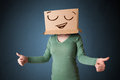 Young woman gesturing with a cardboard box on her head with smil Royalty Free Stock Images