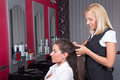 Young woman getting a new haircut by hairdresser at barbershop attractive women Royalty Free Stock Photography