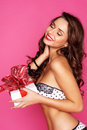 Young woman with a gift Stock Image