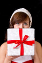 Young woman with gift box isolated on black Stock Images
