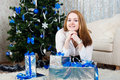 Young woman with gifts near a Christmas tree Royalty Free Stock Images
