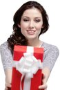 Young woman gives a gift Stock Images
