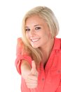 Young woman gives thumbs up sign Royalty Free Stock Images