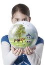 Young woman giving farm globe Royalty Free Stock Photo