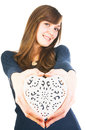 Young woman giving white ornate heart beautiful in hands for valentine s day isolated on background Stock Photo