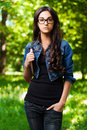 Young woman glasses book underarm Royalty Free Stock Photo