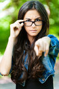 Young woman glasses frown Stock Photography
