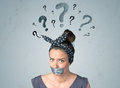 Young woman with glued mouth and question mark symbols Royalty Free Stock Photo