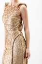 Young woman in golden dress on white background Stock Photos