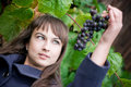 Young woman with grapes Stock Images