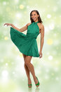 Young woman in green dress portrait of african american over white background Stock Photo