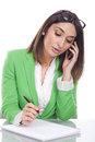 Young woman green jacket on the phone beautiful Royalty Free Stock Photos