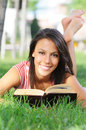 Young woman in green park, book and reading Royalty Free Stock Photo
