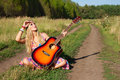 Young woman with guitar Royalty Free Stock Image