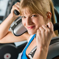 Young woman at gym exercise fitness Stock Images