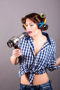 Young woman with hair blower portrait of Royalty Free Stock Photo