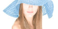 Young woman with half hidden face under blue hat. Stock Photos
