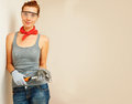 Young woman with hammer in hands looking at camera and smiling Royalty Free Stock Photography
