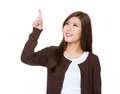 Young woman hand touch the imaginary button isolated on white background Royalty Free Stock Photography