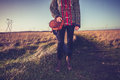 Young woman with handbag standing on nature trail is a Royalty Free Stock Photos