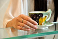 Young woman hands with tea cup Royalty Free Stock Image