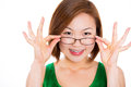 A young woman happy holding showing her new glasses smiling eyewear on white background Stock Photo