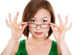A young woman happy holding showing her new glasses smiling eyewear on white background Stock Images
