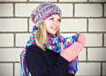 Young woman happy smiling face with coffee cup winter time wearing knitted sweater hat and scarf mittens lifestyle concept Royalty Free Stock Photography