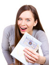Young woman is happy to get a visa in her passport Stock Photo