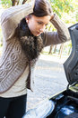 Young woman has a car breakdown beautiful having trouble Stock Photos