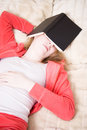 Young woman has fallen asleep reading the book Royalty Free Stock Photography