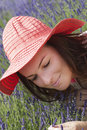 Young woman with hat in a lavender garden beautiful caucasian brunette red Royalty Free Stock Images