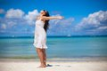 Young woman have fun on beach vacation walking like a bird this image has attached release Royalty Free Stock Photography