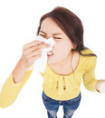Young woman having allergy and blowing into tissue over white Stock Image