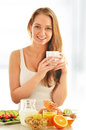 Young woman having breakfast balanced diet Stock Photography