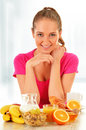 Young woman having breakfast balanced diet Royalty Free Stock Photography