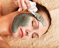 Young woman  having clay body mask. Royalty Free Stock Photography