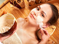 Young woman  having clay facial mask. Stock Photography
