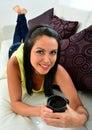 Young woman having coffee sitting on sofa portrait of beautiful Stock Image