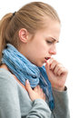 Young woman having a cold portrait of an coughing with fist Royalty Free Stock Image