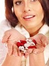 Young woman having flu takes pills isolated Stock Photos