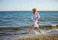 Young woman having fun on beach Royalty Free Stock Photo