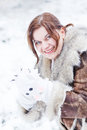 Young woman having fun with snow on winter day beautiful outdoors beautiful Stock Photo