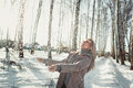 Young woman having fun in the winter forest prettty Stock Images