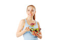 Young woman having a healthy and fresh salad isolated on white Royalty Free Stock Photo
