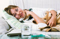 Young woman having heavy sickly quinsy unhappy in domestic interior Stock Image