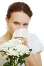 Young woman having spring flowers allergy sneezing Stock Photography