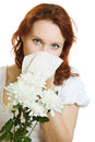 Young woman having spring flowers allergy sneezing Stock Images