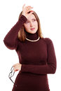 Young woman with headache feeling bad black glasses touching her forehead isolated on white background mask included Royalty Free Stock Image