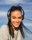 Young woman with headphones listening music outdoor Royalty Free Stock Photo